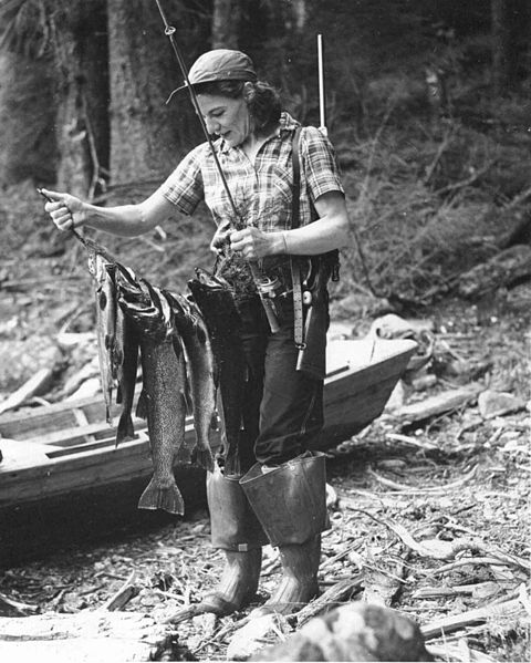 480px-Old_photo_of_woman_holding_a_fisherman_caught_fish